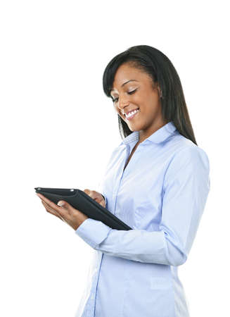 Young smiling black woman using tablet computer Banque d'images