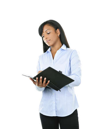 leatherette: Young serious black woman writing in leather portfolio folder Stock Photo