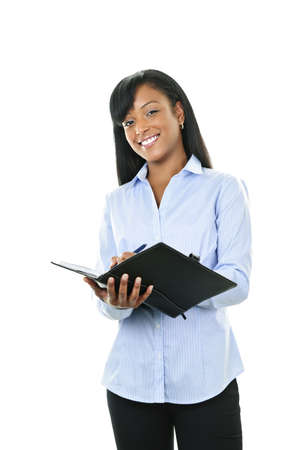 notebook: Young smiling  black woman writing in leather portfolio folder