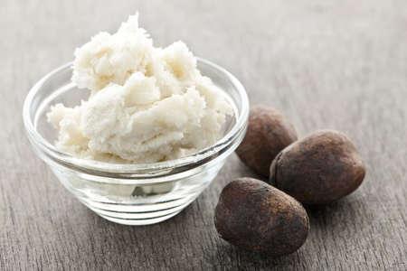 shea butter: Shea nuts and sheabutter in glass bowl Stock Photo
