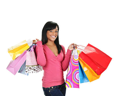 Young smiling black woman holding colorful shopping bags Stock Photo - 8967330