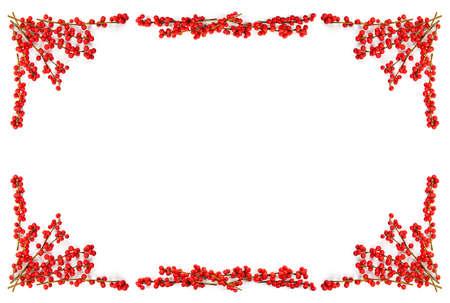 枝にヒイラギの果実を持つ赤い winterberry クリスマス フレーム 写真素材