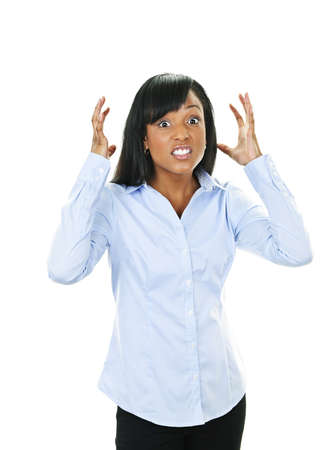 outrage: Frustrated black woman with arms raised isolated on white background
