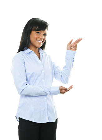 Smiling black woman pointing to the side isolated on white background Stock Photo - 9141285