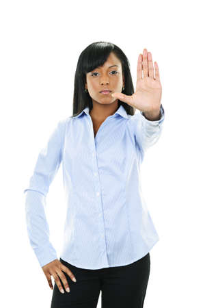 Serious black woman showing stop hand gesture isolated on white background photo