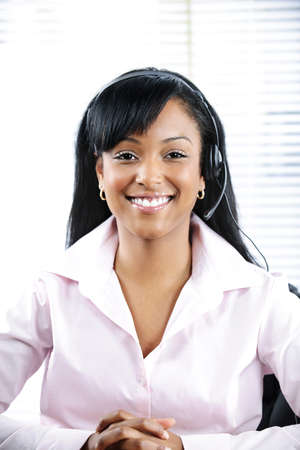 Smiling black customer service and support woman wearing headset Stock Photo - 9134342