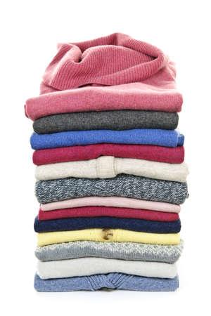 暖かいセーター白い背景で隔離のスタック