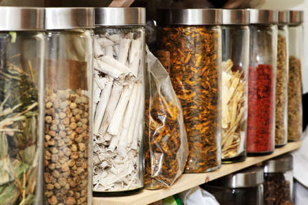 dried herb: Traditional chinese medicine herbs and remedies in jars Stock Photo