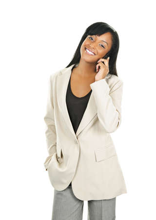 Young smiling black businesswoman on cell phone isolated on white background photo