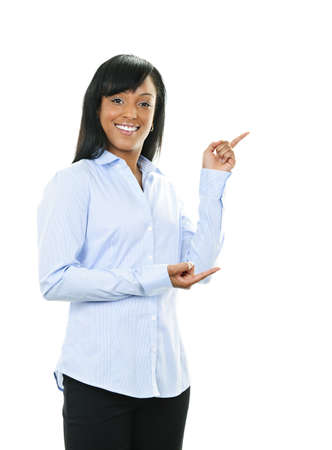 Smiling black woman pointing to the side isolated on white background photo