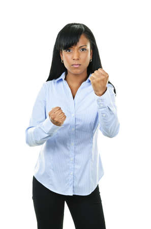 Fighting black woman showing fists isolated on white background photo