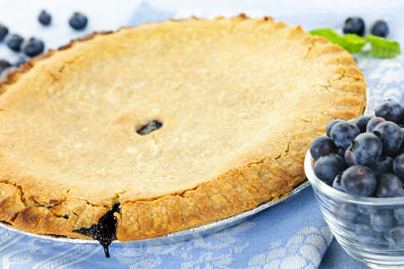 blueberry pie: Whole baked blueberry pie with fresh  blueberries