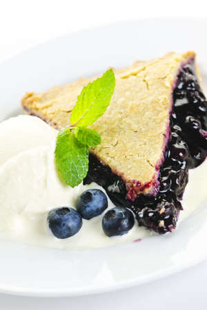 the blueberry: Slice of blueberry pie with vanilla ice cream and berries