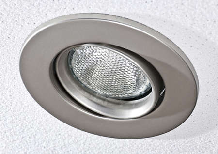 light fixture: Closeup of pot light recessed lighting in ceiling tile Stock Photo