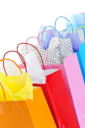 Many colorful shopping bags on white background Stock Photo