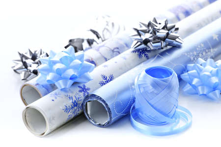 Rolls of Christmas wrapping paper with ribbons and bows photo