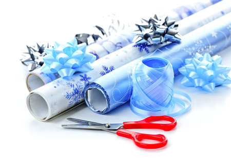 christmas wrapping paper: Rolls of Christmas wrapping paper with ribbons, bows and scissors