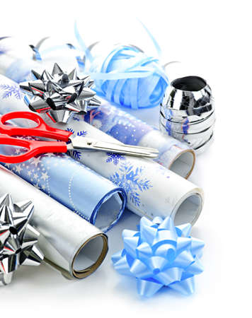 Rolls of Christmas wrapping paper with ribbons, bows and scissors Stock Photo - 9252075