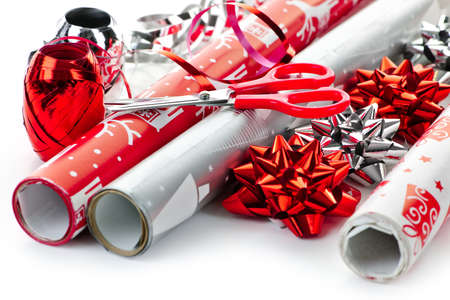 gift wrap: Rolls of Christmas wrapping paper with ribbons, bows and scissors