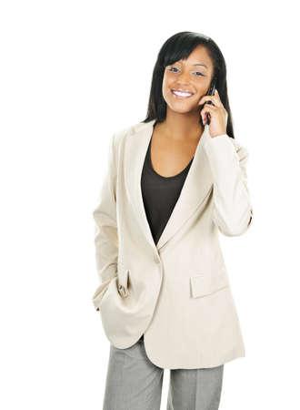 흰색 배경에 고립 된 휴대 전화에 젊은 행복 검은 사업
