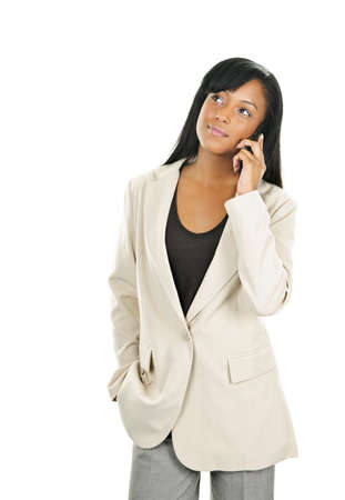 Young serious black businesswoman on cell phone looking up Stock Photo - 9304045