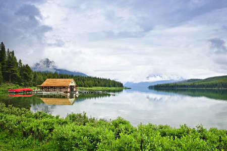 boathouse: Canoes at boathouse on Maligne Lake in Jasper National Park, Canada Stock Photo