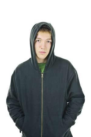 sudadera: Graves joven permanente vistiendo hoodie aislado en fondo blanco Foto de archivo