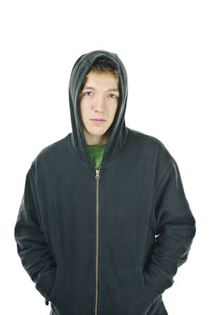 hooded: Serious young man standing wearing hoodie isolated on white background