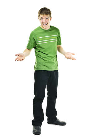 shrugging: Shrugging smiling young man standing isolated on white background Stock Photo