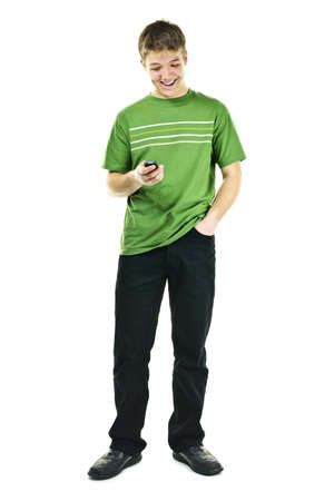 Happy young man texting on cellphone standing full body isolated on white background photo