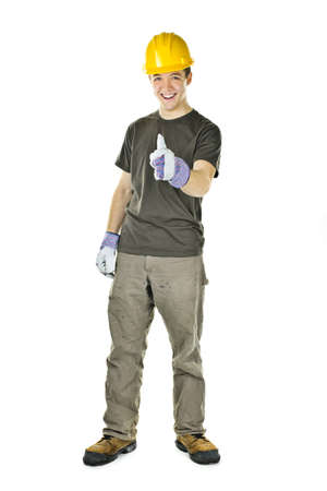 thumb's up: Smiling construction worker showing thumbs up isolated on white background