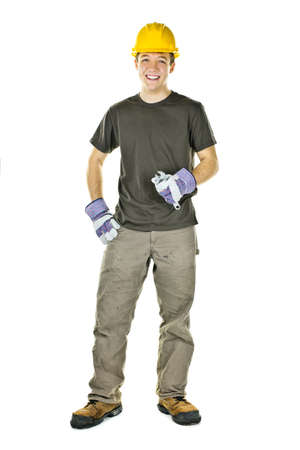 Smiling construction worker holding wrench isolated on white background Stock Photo - 9304043