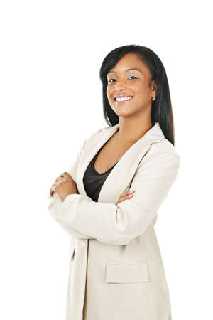 Smiling black businesswoman with arms crossed isolated on white background photo