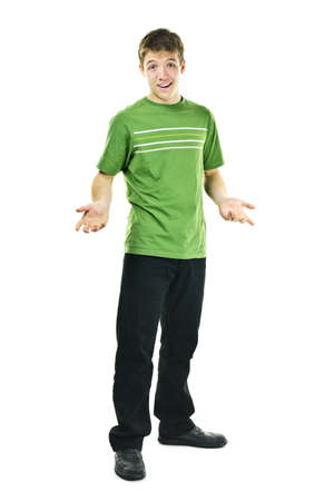 shrugging: Shrugging young man standing isolated on white background Stock Photo