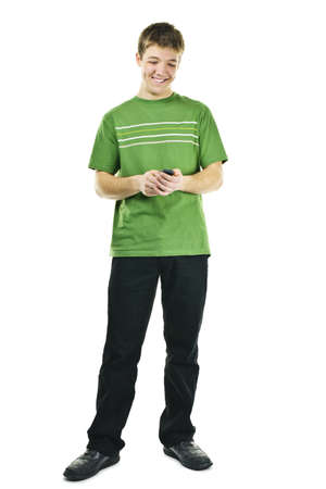 Happy young man texting on cellphone standing full body isolated on white background Stock Photo - 9379170