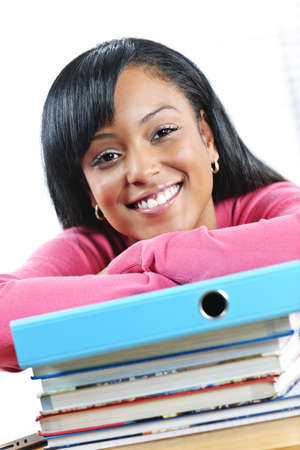 Smiling young black female student with textbooks at desk Stock Photo - 9379237