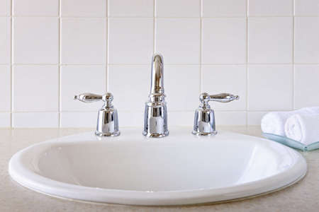 bathroom sink: Bathroom interior with white sink and faucet