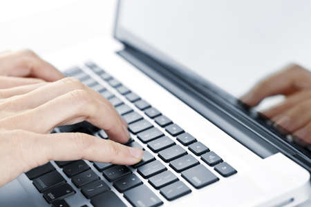 Hands typing on laptop computer keyboard close up Stock Photo - 9417860