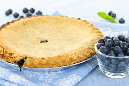 Whole baked blueberry pie with fresh  blueberries photo