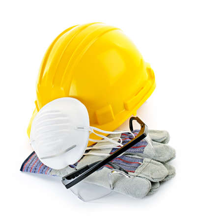 safety gloves: Construction safety equipment with hard hat, respirator, goggles and gloves isolated on white