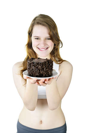 tempted: Smiling young woman tempted by a delicious chocolate cake