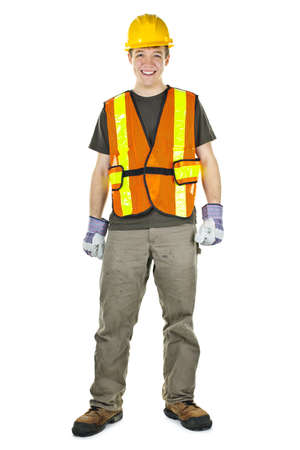 safety gloves: Happy male construction worker standing in safety vest and hard hat Stock Photo