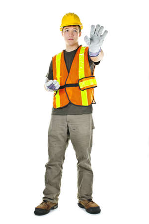 Male construction worker directing with hand signals in vest and hard hat Stok Fotoğraf