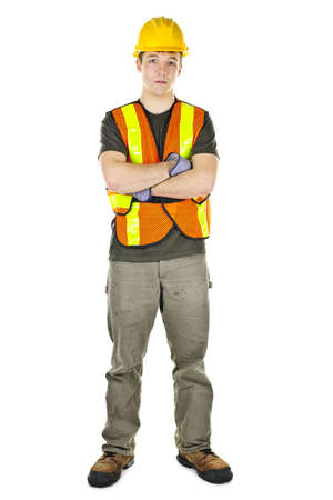 Serious male construction worker in safety vest and hard hat photo