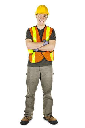 hard worker: Sorridente maschio muratore in giubbotto di sicurezza e cappello rigido Archivio Fotografico