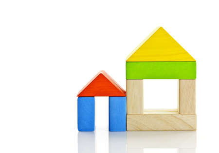 Houses built out of toy wooden building blocks
