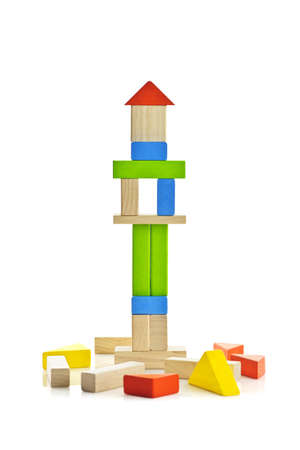 tower block: Tower of wooden building block toys isolated on white background Stock Photo
