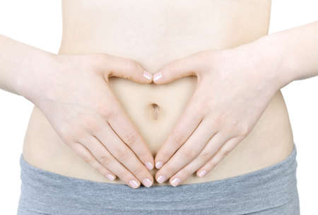 stomach: Woman showing heart shape with her hands on stomach