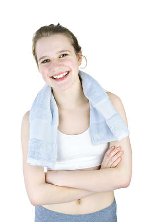 Happy fit young woman after workout on white background photo