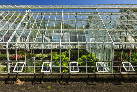 Large glass greenhouse or hothouse building exterior with plants photo